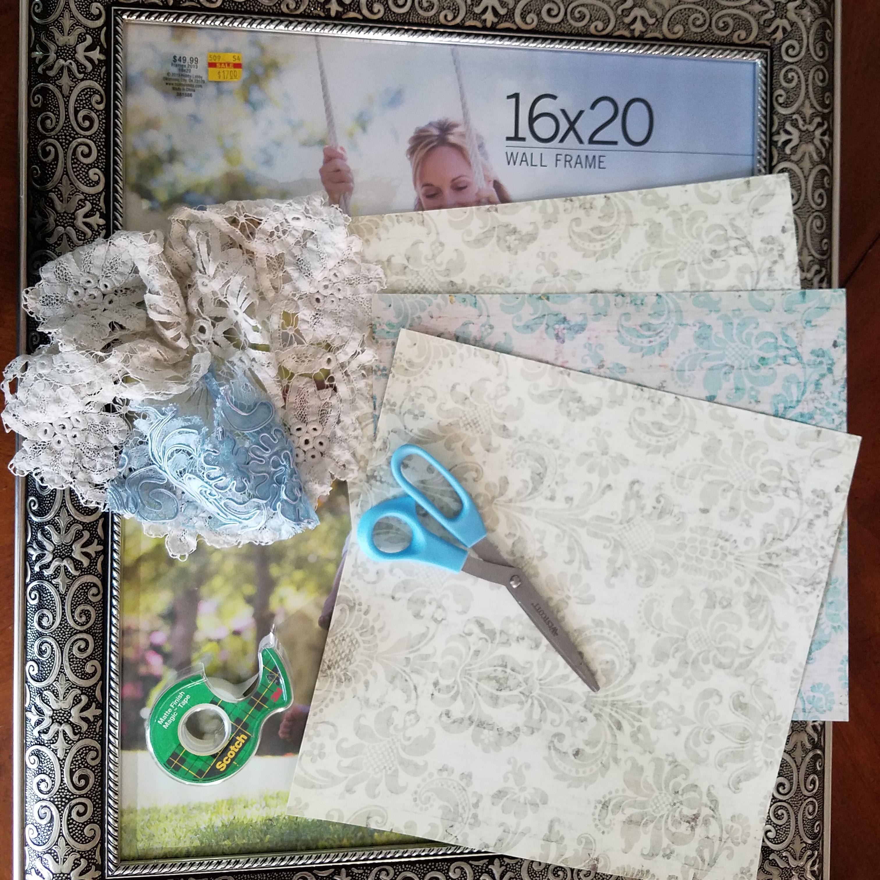 16x20 metal frame, scissors, tape, paper, doilies